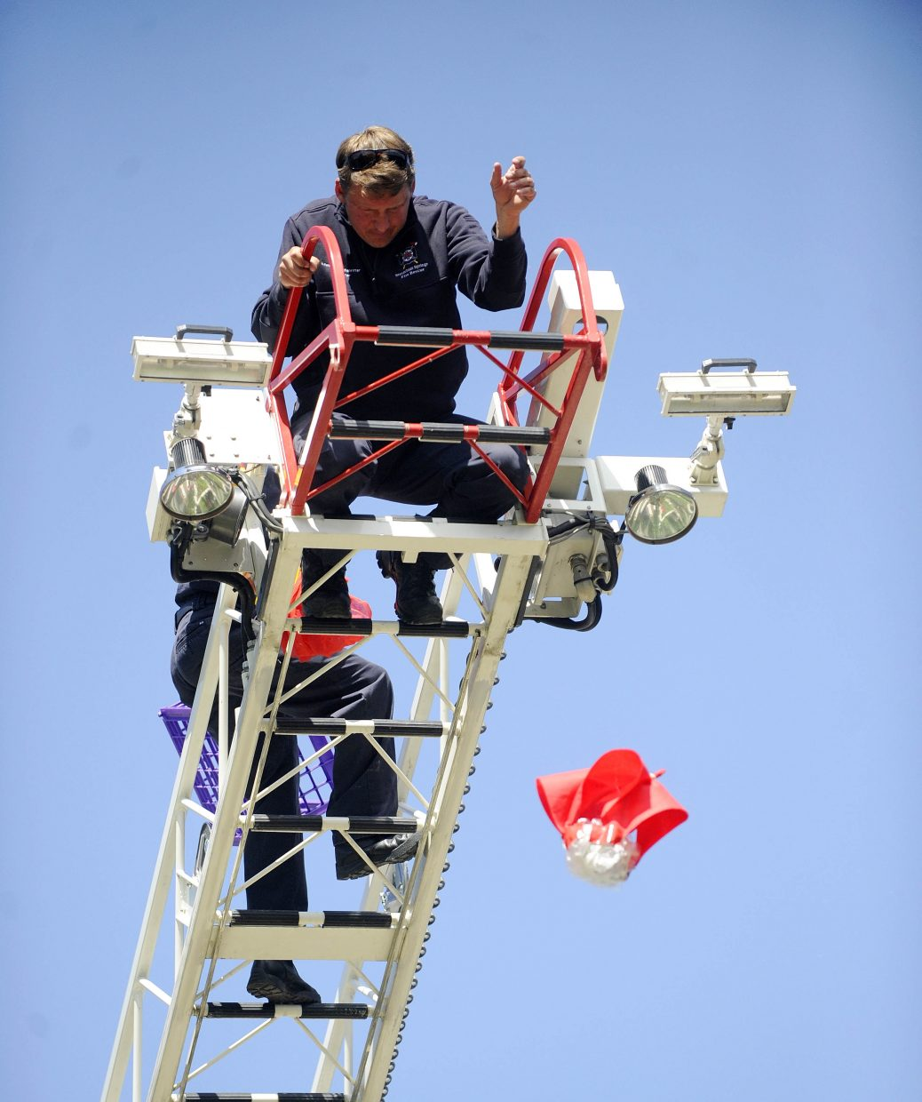 Steamboat Springs Fire Rescue firefighter Louis Gutschenritter drops one of the egg drop vessel made by children Thursday at Bud Werner Memorial Library.