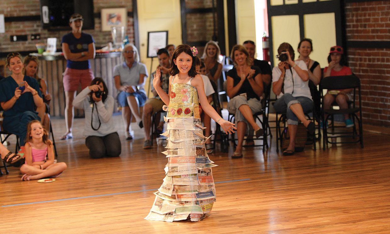 Sophie Cowman shows off her creation during the Young at Art Paper Fashion Show at the Arts Depot Friday afternoon. The show, where the models created their fashion entirely from paper, is part of the Arts Council's Young at Art Summer Creativity Camps, which take place throughout the summer. Any one interested in taking part can go to the Steamboat Arts Council's website at steamboatarts.org or all call the Arts Council at 879-9008 for more information.
