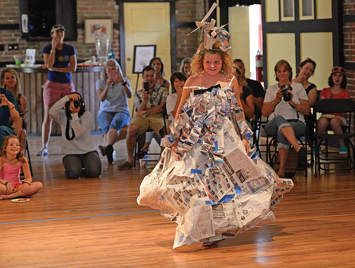 Mahala Wyant looks like the bell of the ball as she shows off her creation during Friday afternoon's Young at Art Paper Fashion show. The show, where the models created their fashion entirely from paper, is part of the Arts Council's Young at Art Summer Creativity Camps, which take place throughout the summer. Any one interested in taking part can go to the Steamboat Arts Council's website at www.Steamboatarts.org or all call the Arts Council at 879-9008 for more information.