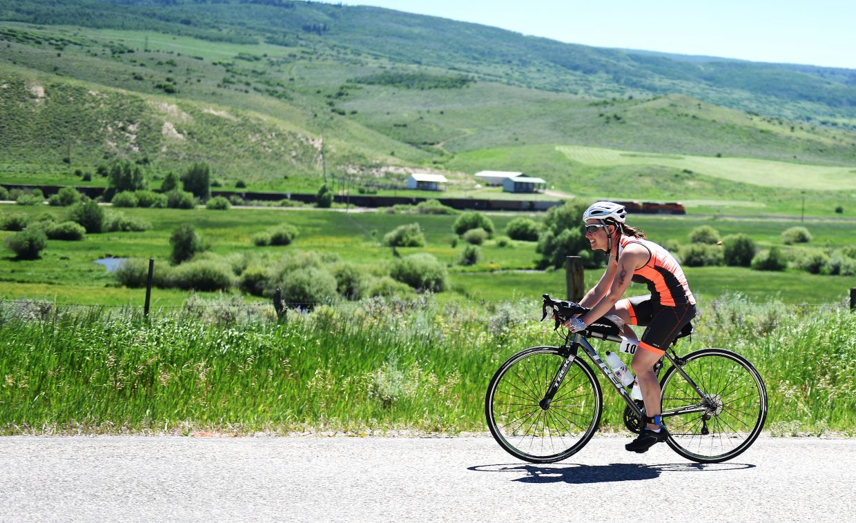 A rider glides through South Routt County on Sunday during the Tri the Boat triathlon.