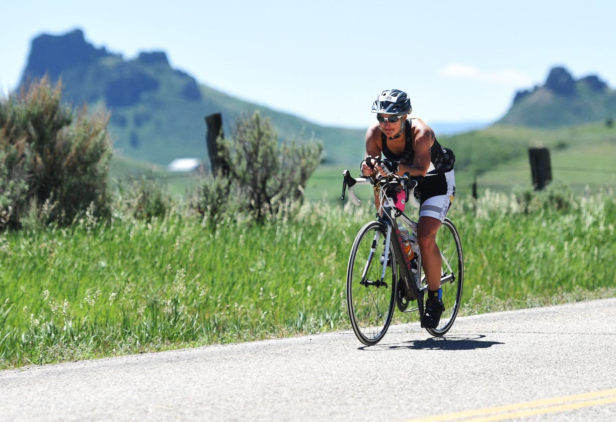 A rider flies toward Phippsburg on Sunday during the Tri the Boat half-Ironman distance triathlon. The race drew 140 starters for a dip in Stagecoach Reservoir, a bike ride south into the county and a run around the lake.