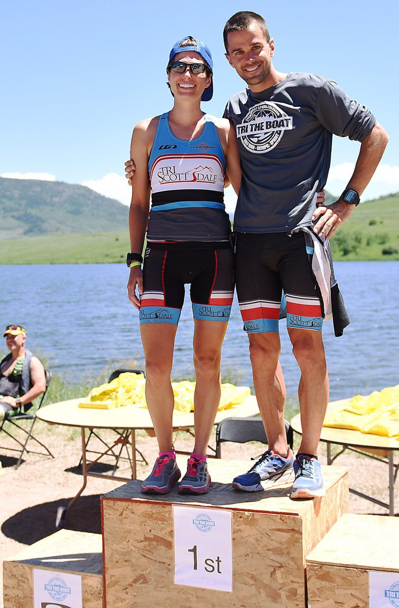 Monica Folts, left, and Brian Folts, a husband-wife triathlon tandem, dominated the weekend's Tri the Boat triathlon series. Each won their gender's division in Saturday's Olympic-distance race and again, in Sunday's half-Ironman event.