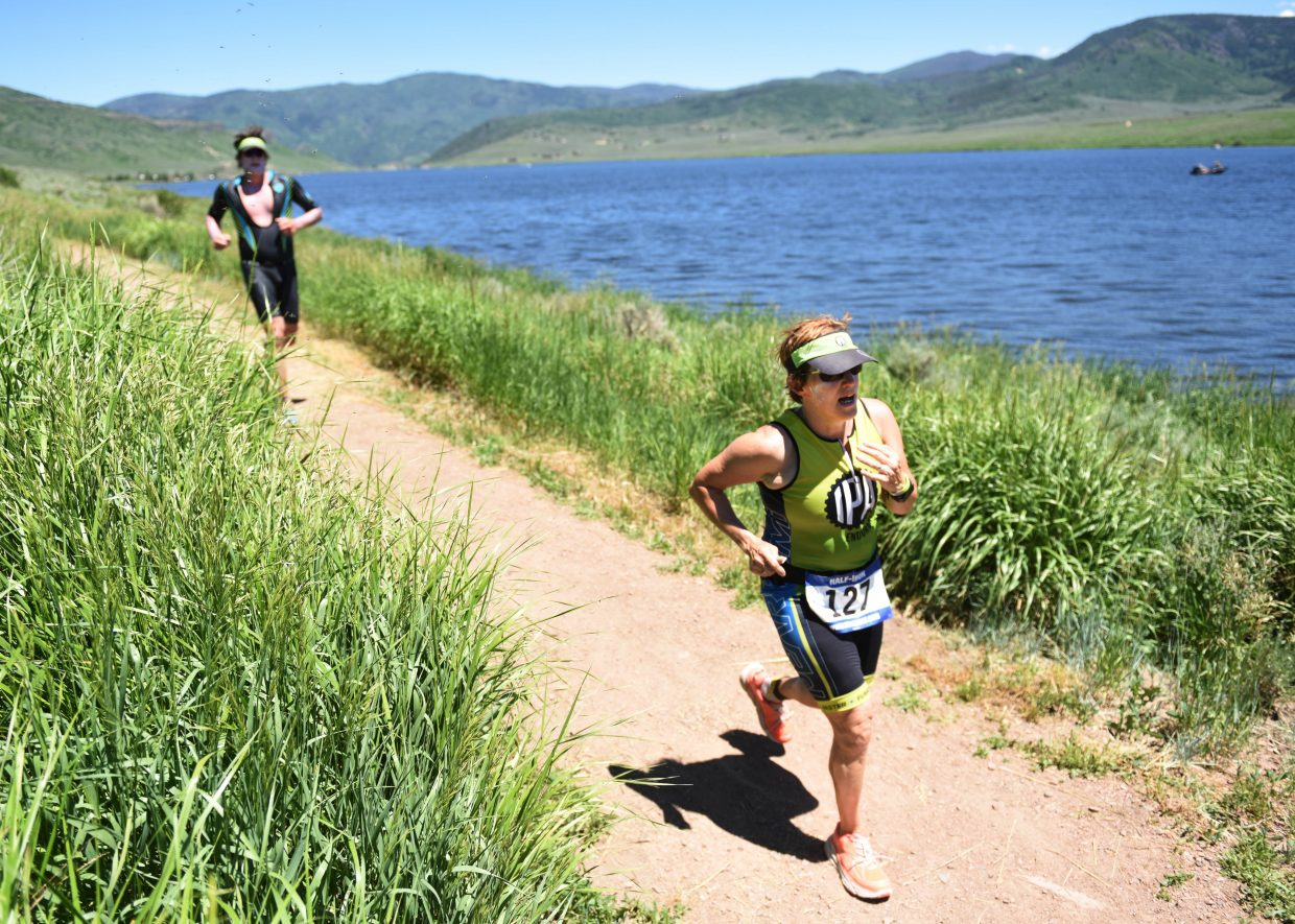 Runners near the finish area at Sunday's Tri the Boat triathlon, which stretched 70.3 miles around South Routt County.