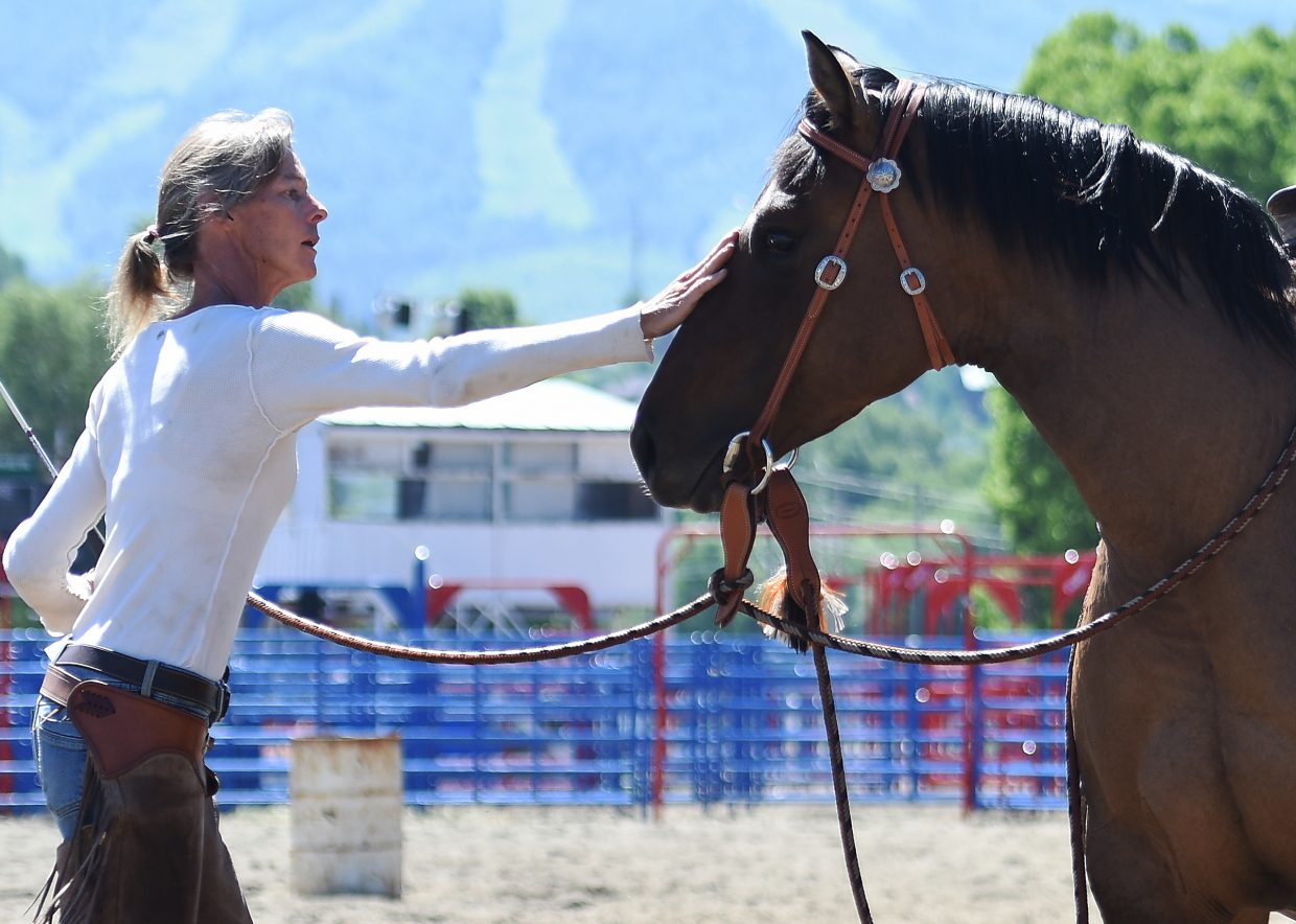 Clare Sibley works with Missy, a 5-year old mare, Sunday morning at Romick Rodeo Arena in downtown Steamboat Springs. Sibley was trying to calm Missy after the horse began the workout aggressive and agitated.