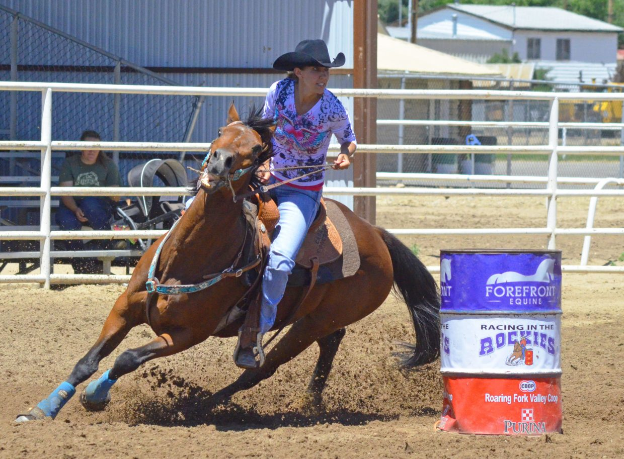Trista Linsacum, of Fruita, and Whole Lotta Axtion spray some dirt while rounding a corner during the Tri-State Barrel Racing Classic Saturday at Moffat County Fairgrounds. More than 100 women of all ages competed the event, open to riders from Colorado, Wyoming and Utah.