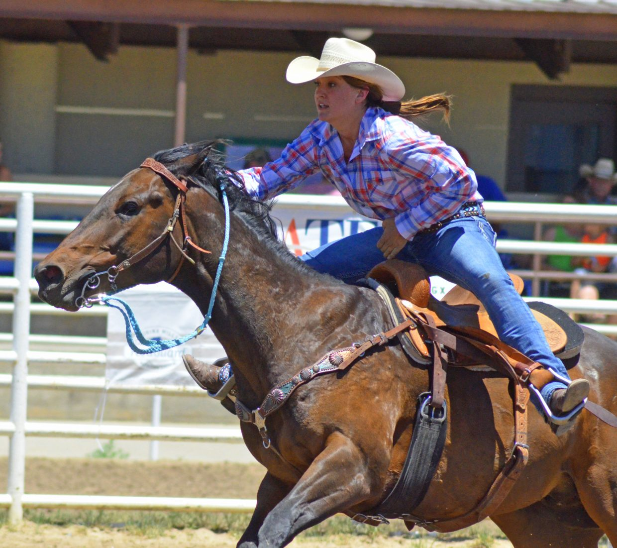 Steamboat Springs rider Haley Scheer and horse Major Hot Streak speed through the course during the Tri-State Barrel Racing Classic Saturday at Moffat County Fairgrounds. Scheer, riding three different horses, won multiple honors in the open segment of the event.