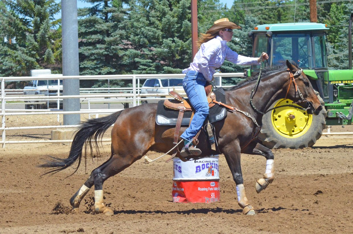 Craig's Kristin Grajeda heads for the finish line after completing the final turn of the course in the arena during the Tri-State Barrel Racing Classic Saturday at Moffat County Fairgrounds.