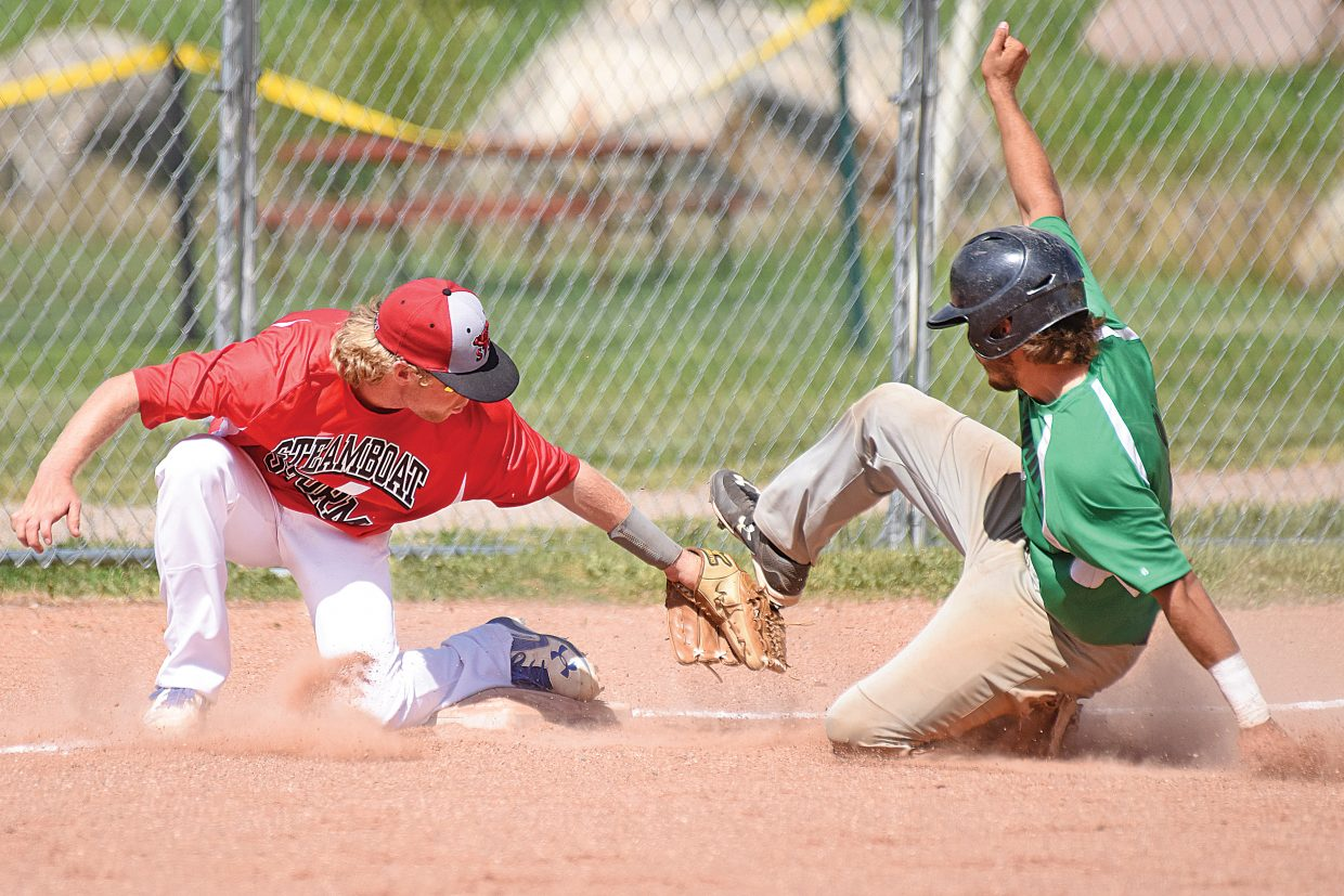 Steamboat Storm infielder Jesse Pugh, one of two Steamboat players on the team, tags out Extreme Black Diamonds Tavin Thompson as the Summit runner attempts to make it to third base in the second half of a double-header at Emerald Park Tuesday afternoon. Steamboat won the first game 8-7 and the second game 5-1. The Steamboat team will host Grand Junction on Thursday before the league leading Glenwood Springs comes to town Friday.