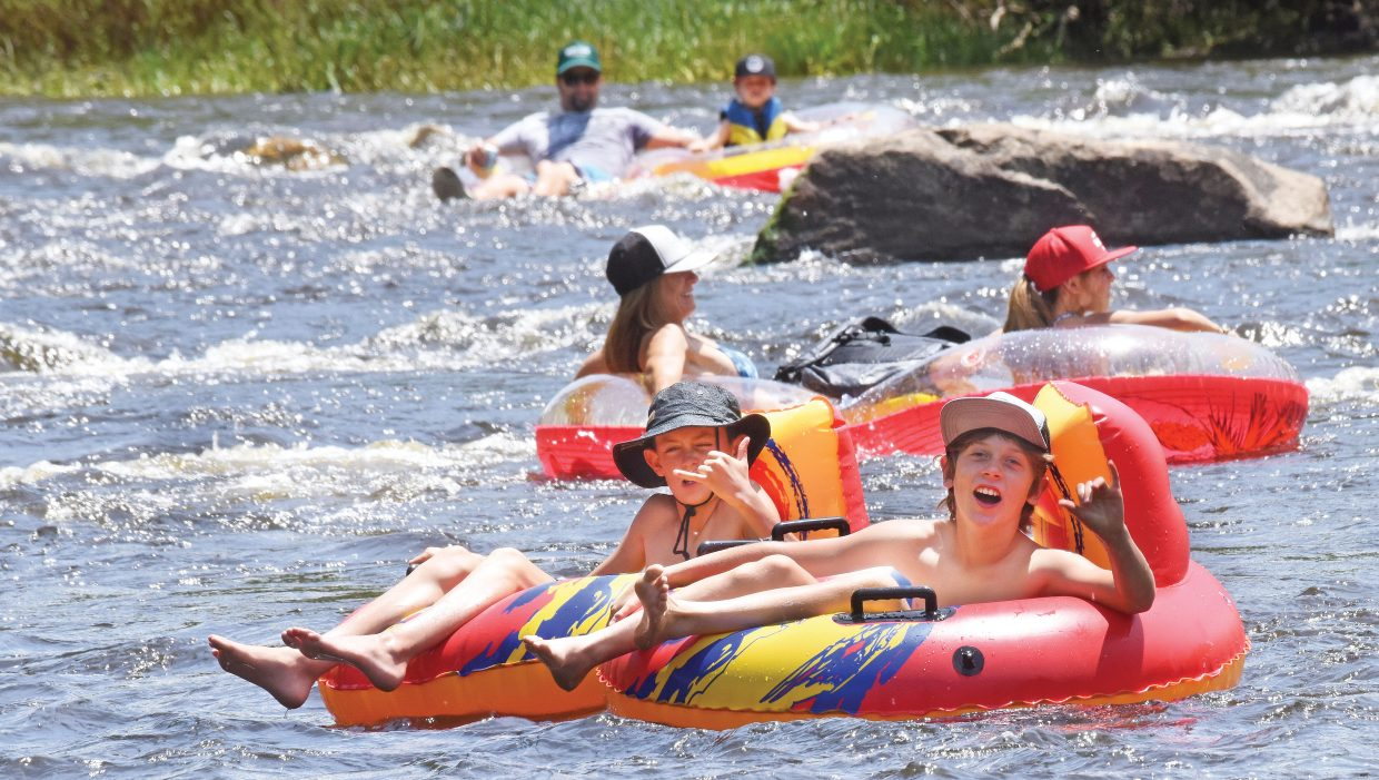 Titus Sherlock, front, and Mitchell Lake float down the Yampa River Wednesday afternoon. The tubing season is sure to heat up over the next few weeks as river flow starts to slow and temperatures continue to get warmer. Steamboat's three commercial tube rental outlets started renting tubes to customers Wednesday but were only renting to those 18 years or older. That age limit is expected to drop over the next couple of days.