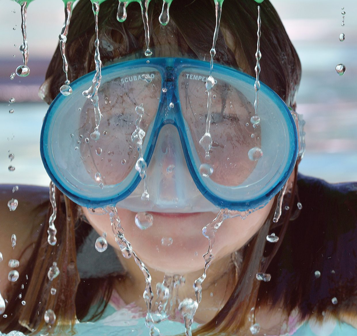Eight-year-old Madison Acker plays at the Old Town Hot Springs pool Monday afternoon while visiting Steamboat Springs from Brighton, Colorado.