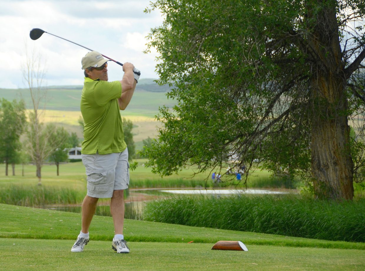 David Brookshire watches his shot from the 15th tee of Yampa Valley Golf Course during the 2014 Cottonwood Classic. This year's event takes place Friday through Sunday at YVGC. Registration is still available at the course, but the final cut-off is noon Wednesday.