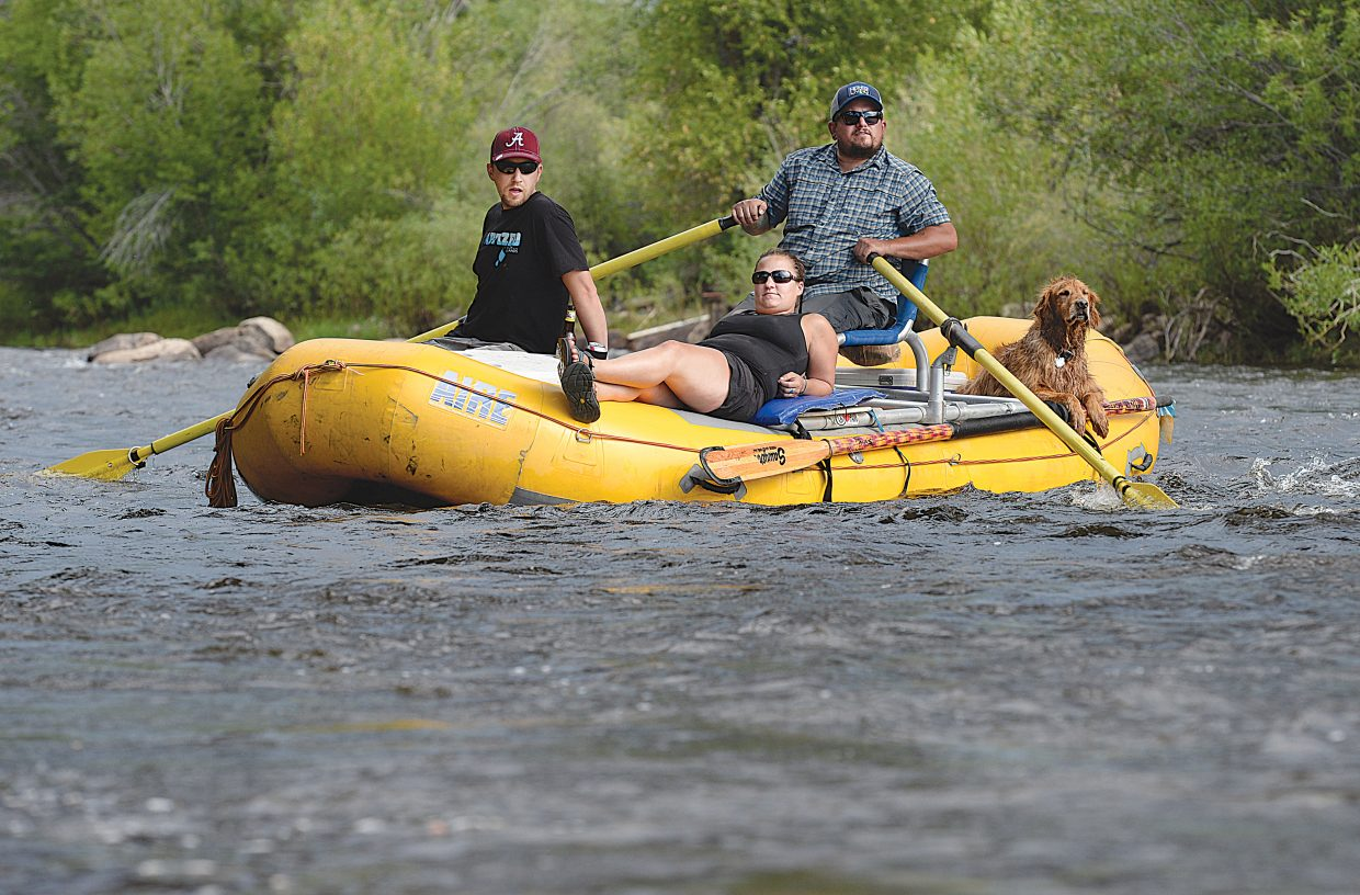 Tuesday proved to be a great day to float down the Yampa River for, from left to right, Cody Elmore, Jessie Levy, Bear LaFerney and Jack.