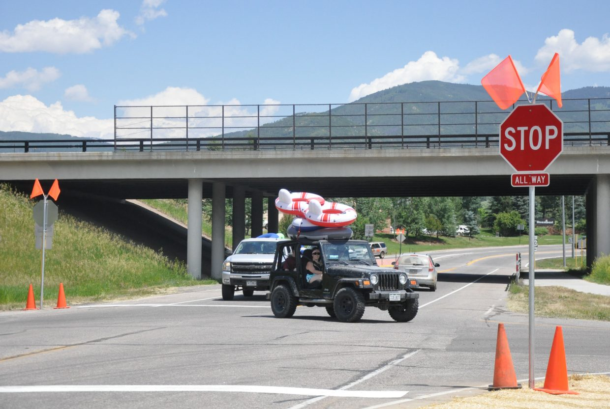 A Jeep carrying several tubes travels through one of the intersections that recently was equipped with new stop signs. City officials said the signs will improve traffic flow and safety of the intersections.
