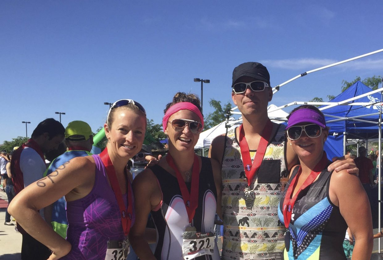 Old Town Hot Springs Triathlon Club members had a strong showing at Saturday's Dino Tri sprint race in Vernal, Utah. From left, Kathy Wichelhaus finished second in her age group, Erin Orr was first in her age group, Matt Stensland was third overall and CJ Berg finished fourth in her age group.