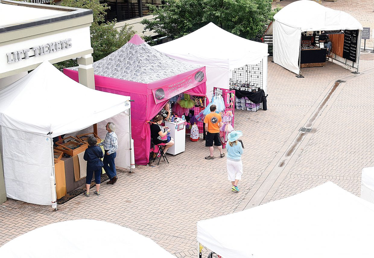 Despite a brief rainstorm Friday vendors and customers gathered at the first day of Art on the Mountain. The event, in its 15th year, is taking place from 10 a.m. until 4 p,m. at Gondola Square through Monday.