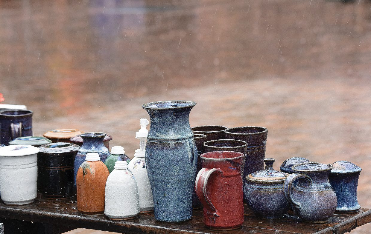 A steady rain showers this pottery Friday on the first day of Art on the Mountain in Gondola Square. The event, now in it's 15th year, brings a wide variety of vendors to the mountain. The show runs from 10 a.m. until 4 p.m. through Monday.