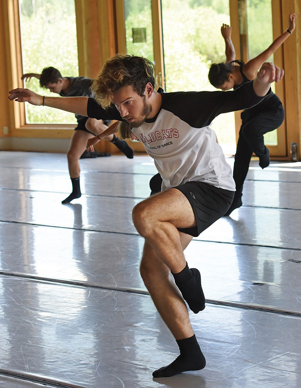 Dancer Ryan Dervin, middle, works through a routine with choreographer Yin Yue during a class of pre-professional dancers at the Perry-Mansfield Performing Arts School and Camp Tuesday. The group will take part in the First Friday Artwalk for the first time, with different groups performing live at six different locations on Lincoln Avenue from 5 to 8 p.m.