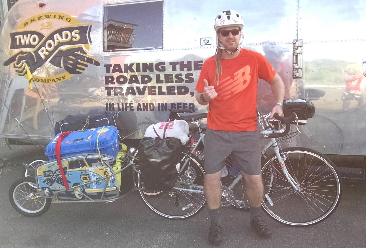 Jup Brown poses before leaving for his huge, nearly 5,000-mile bike ride. He started at the Two Roads Brewing Company in Stratford, Connecticut and knocked out 99 miles on his first day.
