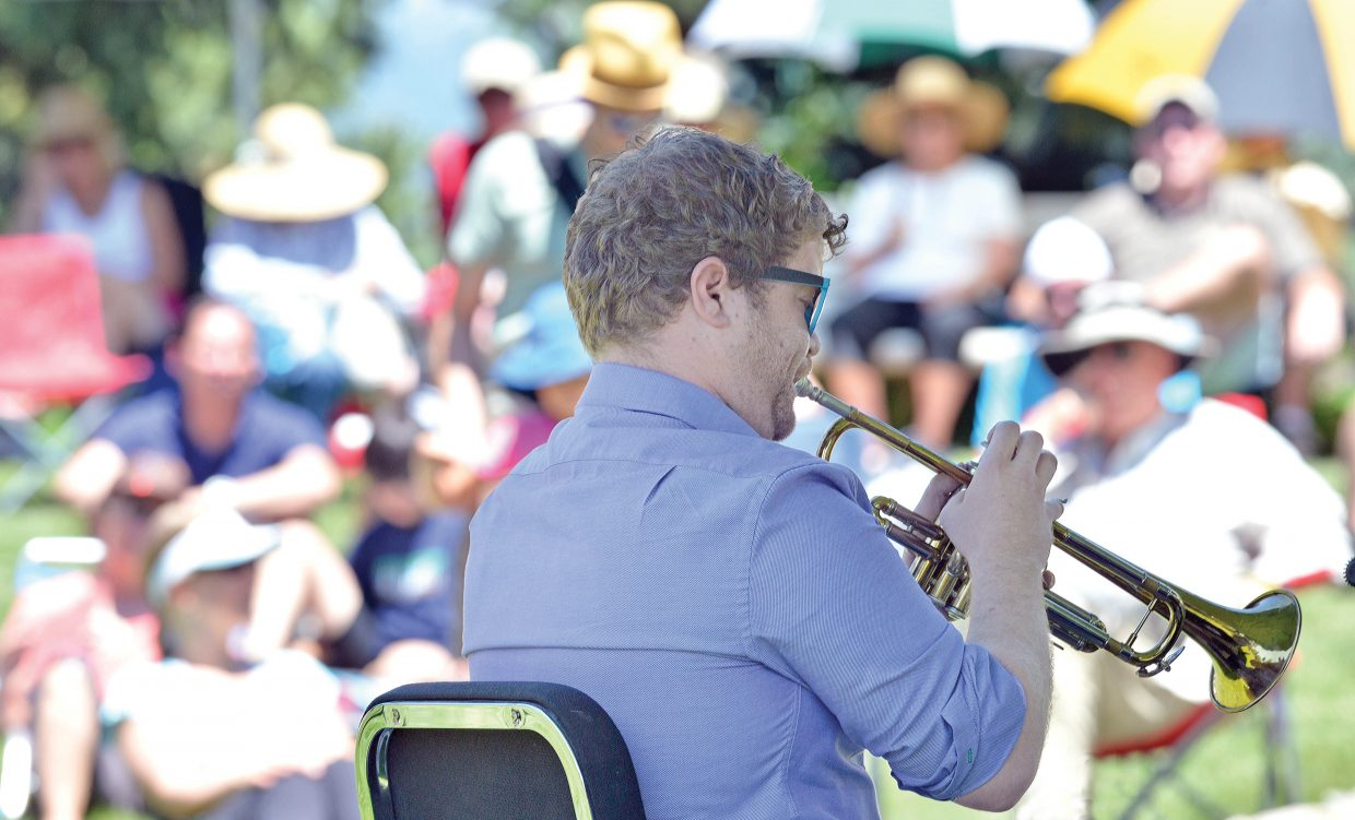 Trumpet player Scott Nadelson, of C Street Brass, entertains a large crowd at the Yampa River Botanic Park on Thursday afternoon during Music on the Green. The show was part of the Strings Music Festival's 15th annual Music on the Green Series.