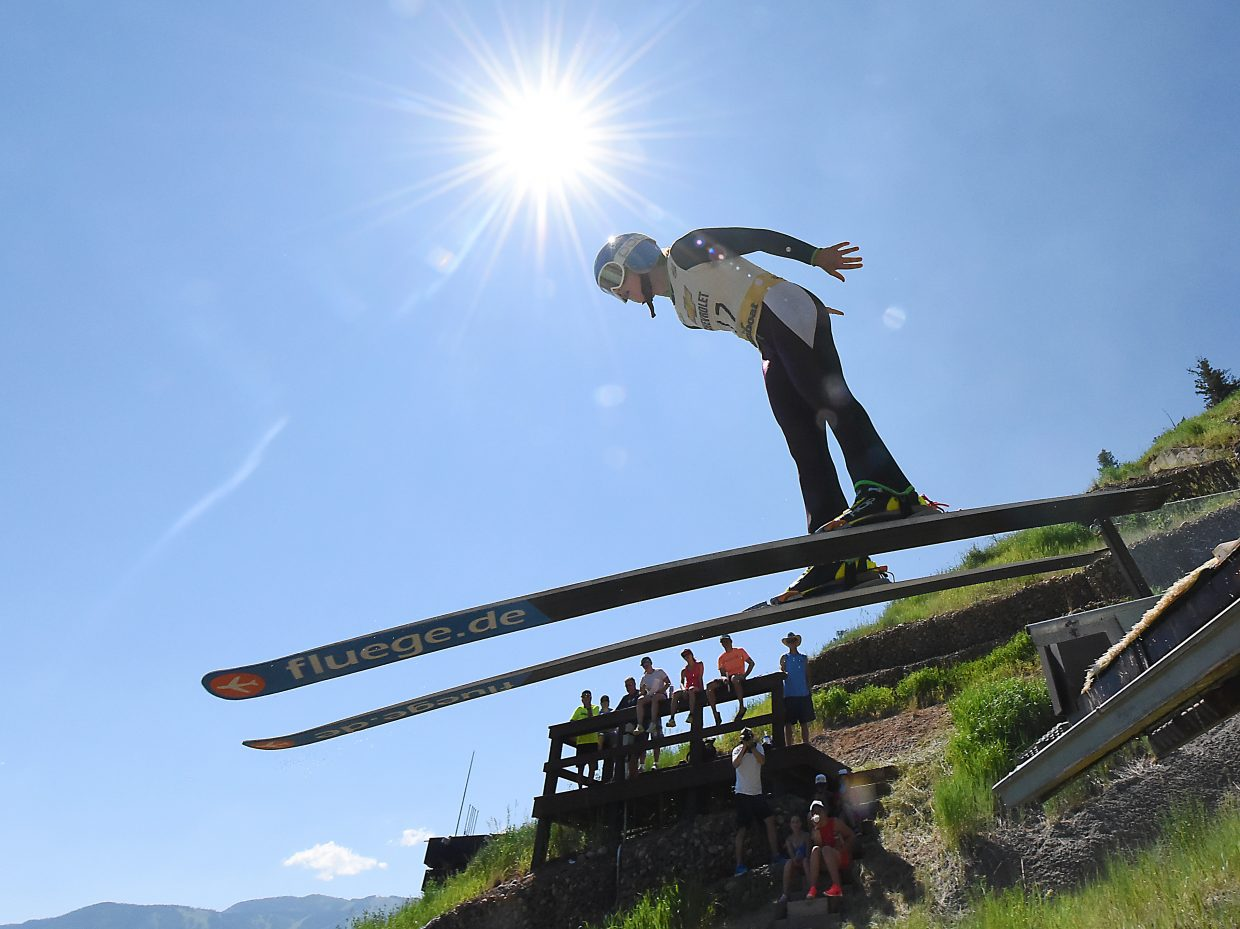 Logan Sankey flies off the HS75 ski jump at Howelsen Hill in Steamboat Springs on Friday. Sankey is among a dozen young women working in Steamboat this week with the Fly Girls Camp.
