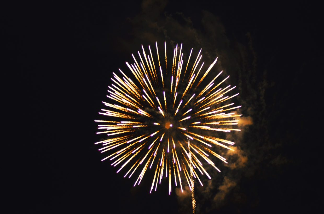 An explosion of gold is among the first of the fireworks set off by Craig Fire/Rescue as part of the Fourth of July fireworks display at Moffat County High School Friday night.