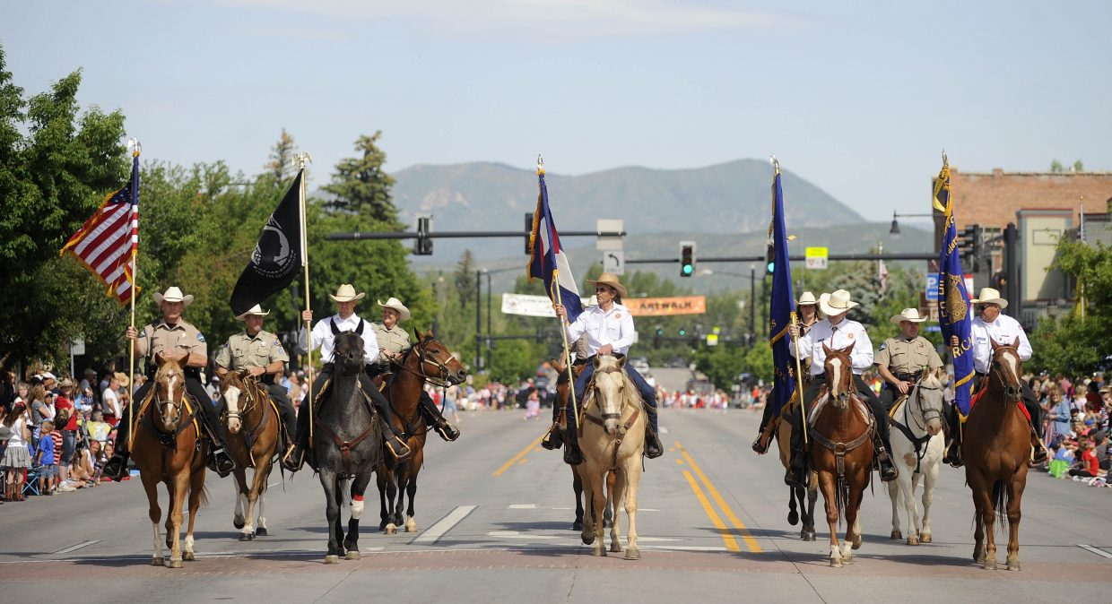 The color guard marches down Lincoln Avenue during the Fourth of July parade.
