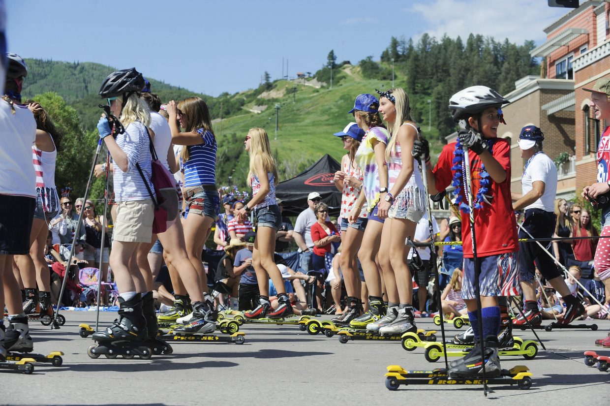 Steamboat Springs Winter Sports Club members roller ski down Lincoln Avenue during the July 4 parade.
