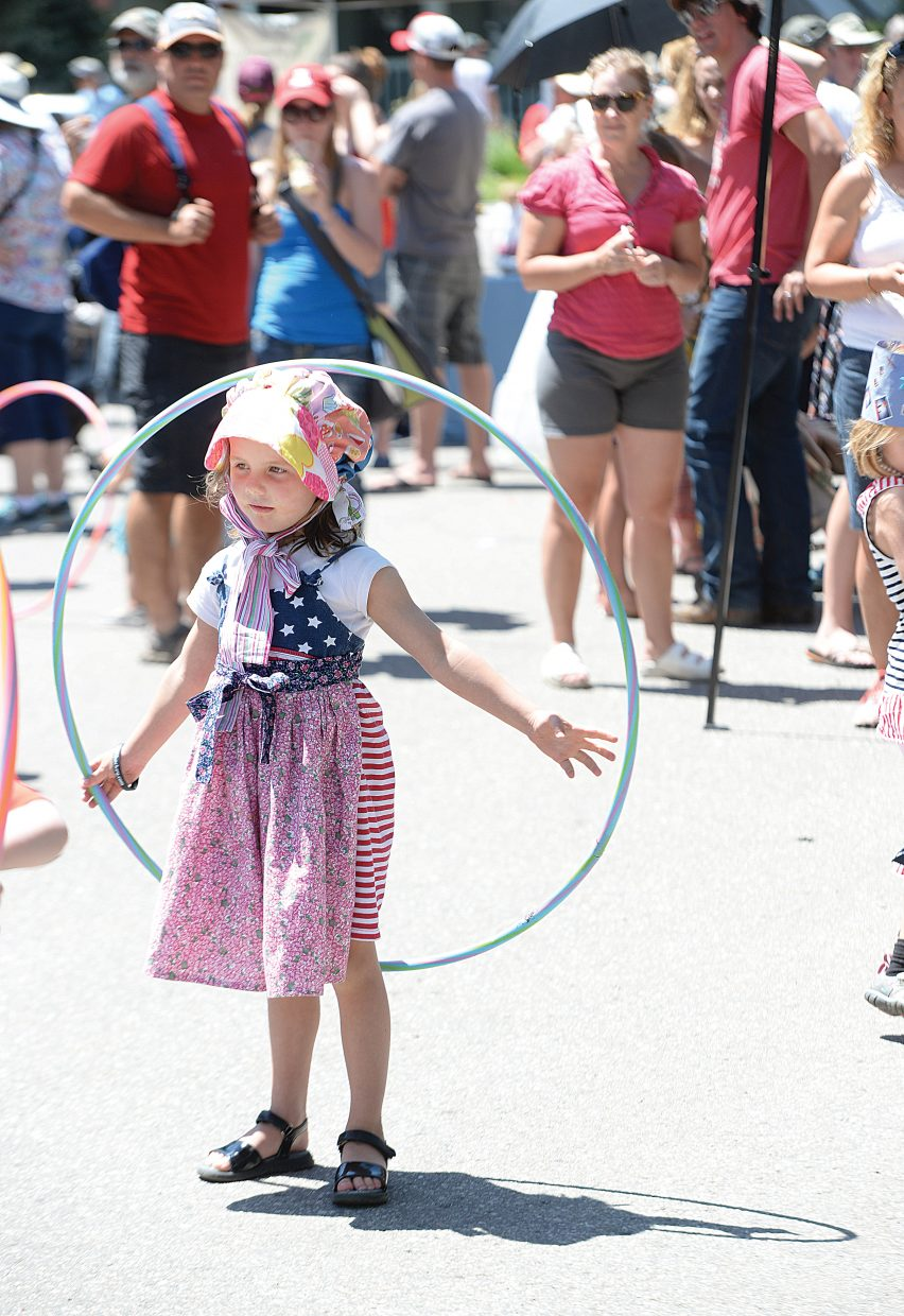 Leah Bannister plays with a hula hoop during the Pioneer Day Block Party that took place in front of the Tread of Pioneers Museum following the annual Yampa Valley Bank Fourth of July Parade Monday. The block party included tours of the museum, Routt beer floats and music by the Steamboat Springs Big Band.