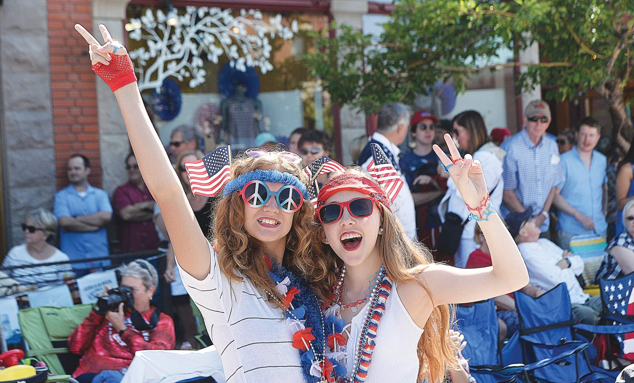 Brooke Thompson, left, and Ella Galaty celebrate the holiday in style Monday during the Yampa Valley Bank Fourth of July Parade in downtown Steamboat Springs. Thousands of people showed up downtown to watch floats male their way down Lincoln Avenue as part of the annual tradition.