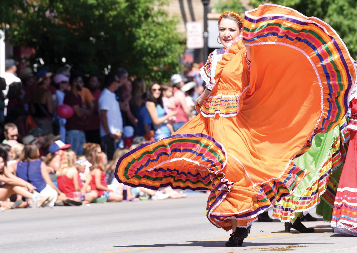 Dancer Sahara Barragan entertains the large crowd that packed Lincoln Avenue Monday for the annual Fourth of July Parade. Barragan was part of a float entry by the owners of Fiesta Jalisco and Vaqueros Mexican Restaurant and Taqueria.