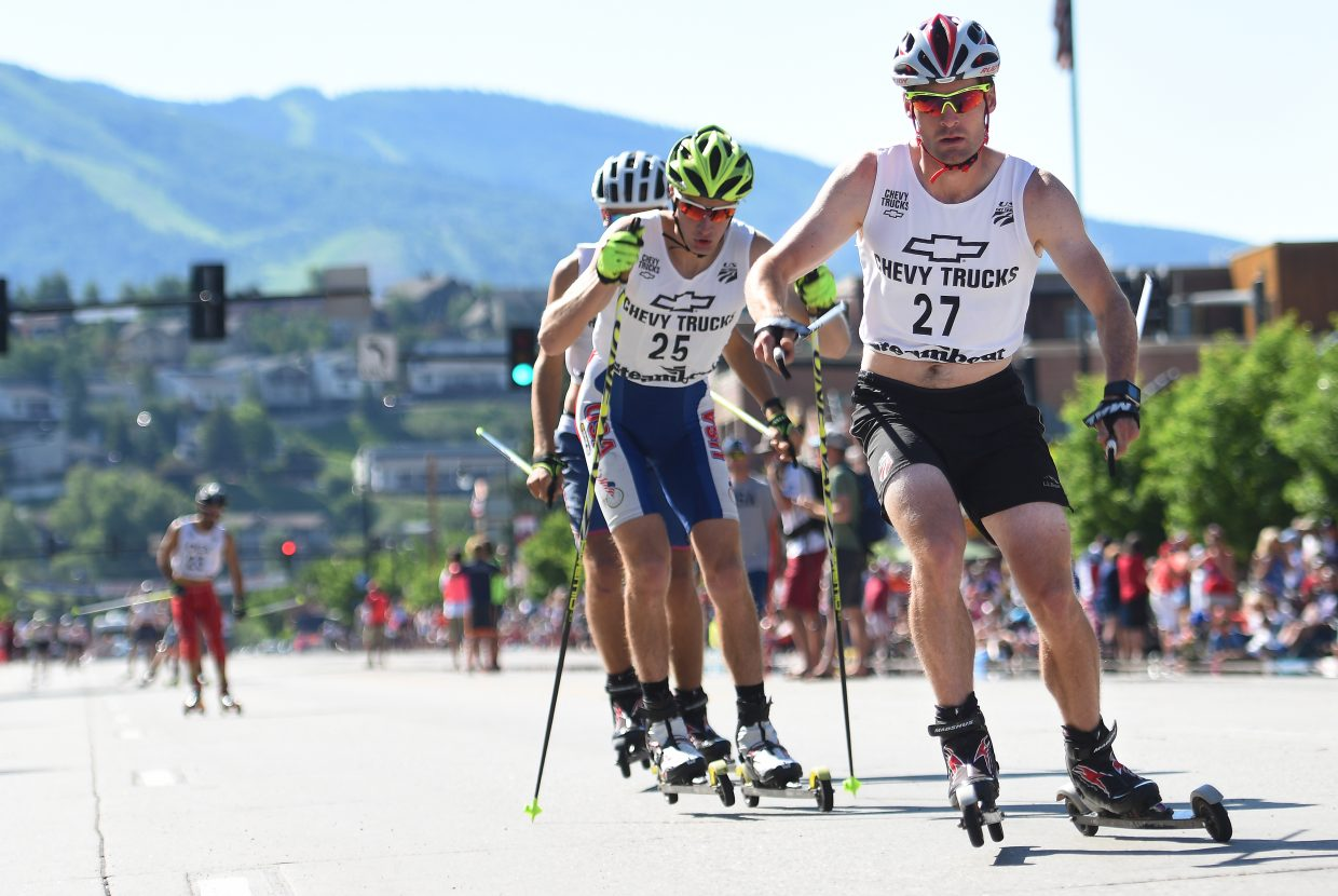Bryan Fletcher, right, leads a pack of skiers during Monday's Lincoln Avenue roller ski race in downtown Steamboat Springs. Fletcher went on to win the Nordic combined event.