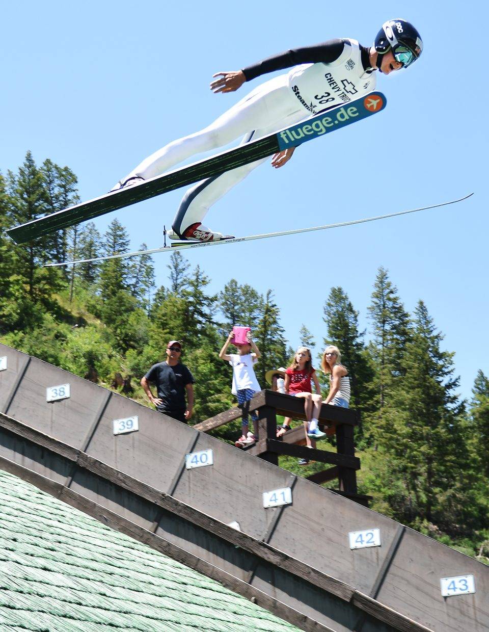 Steamboat Springs Nordic combined skier Jasper Good flies above the crowd Monday at Howelsen Hill.