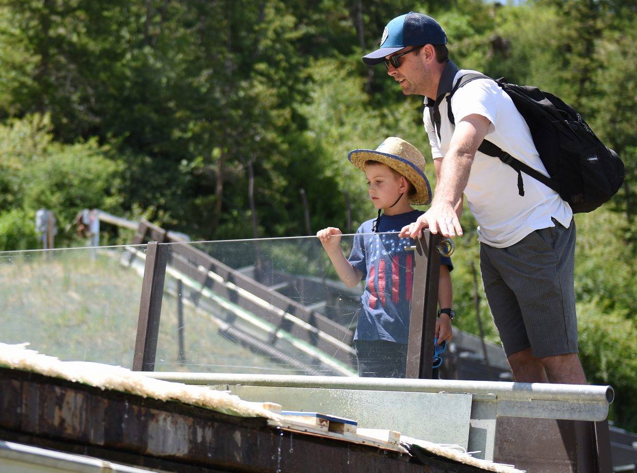 Ryan Heckman, a former member of the U.S. Nordic Combined Ski Team, shows off the jump at Howelsen Hill to his son, Chase, 7.