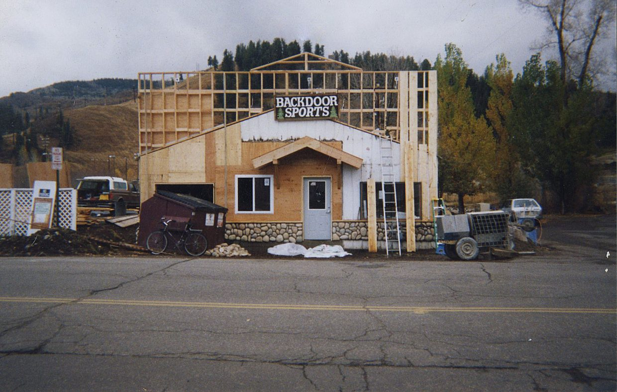 A false facade is constructed at the front of Backdoor Sports in the 1990s. The building used to be a diesel repair shop.
