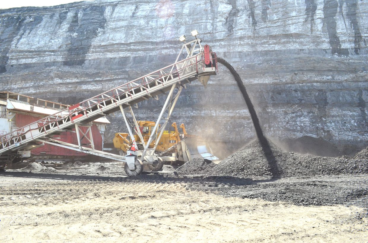 Coal is being removed from the high wall at Colowyo. A high wall digs into a mined wall and extracts coal from a seam in between layers of other material and soil.