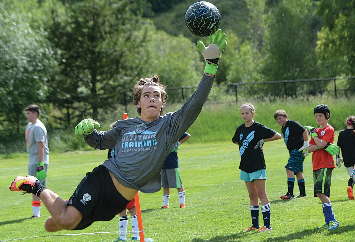 Steamboat Springs soccer player Murphy Bohlmann reaches for a ball during a drill on the opening day of the Steamboat Soccer Academy in Steamboat Springs. The first session of the academy drew 175 players and will run through Friday. A second camp is scheduled to begin Sunday of the following week and will bring in just under 200 players to town before the start of the Steamboat Mountain Soccer Tournament, which will run July 14 to 17 in Steamboat.