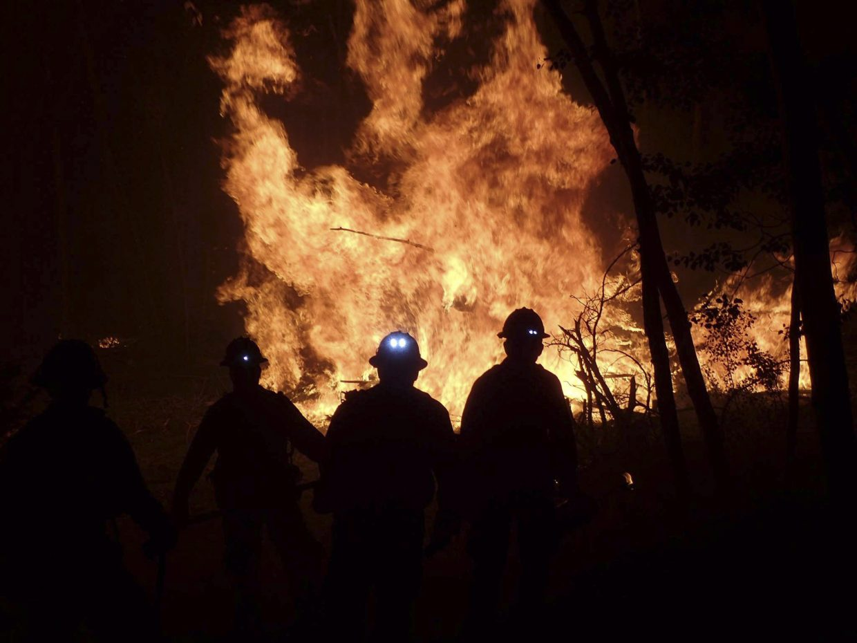 Photos from night operations during previously active periods at the Beaver Creek Fire.
