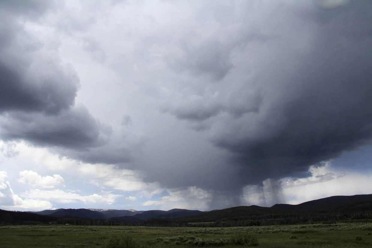 A shot of virga (streaks of water drops or ice particles falling out of a cloud and evaporating before reaching the ground) falling over the Beaver Creek Fire. J Michael Johnson