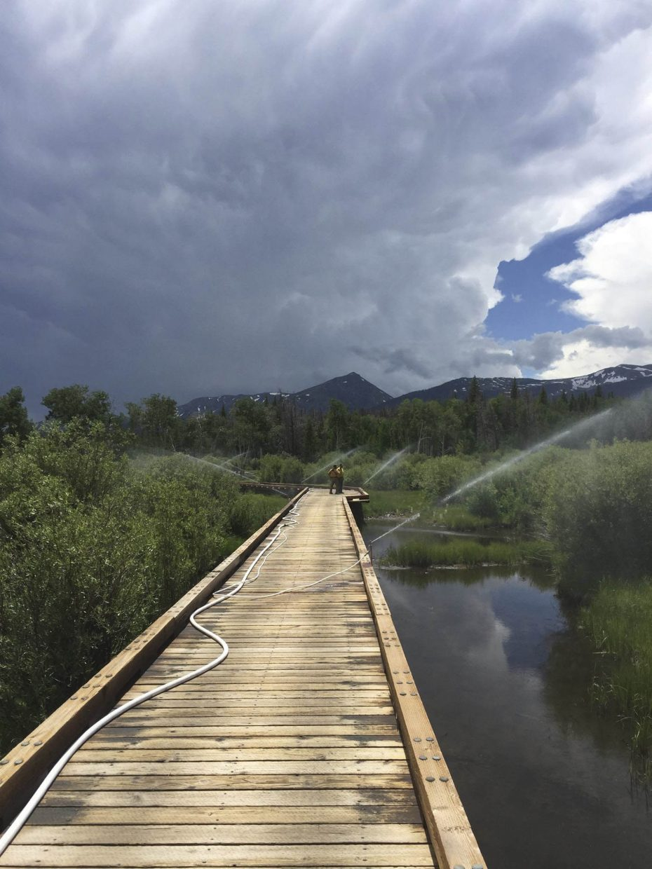 Sprinklers are in place on the Grizzly Helena ATV bridge in the event the Beaver Creek Fire moves south and threatens this structure. The fire is still 3 miles north of this facility.