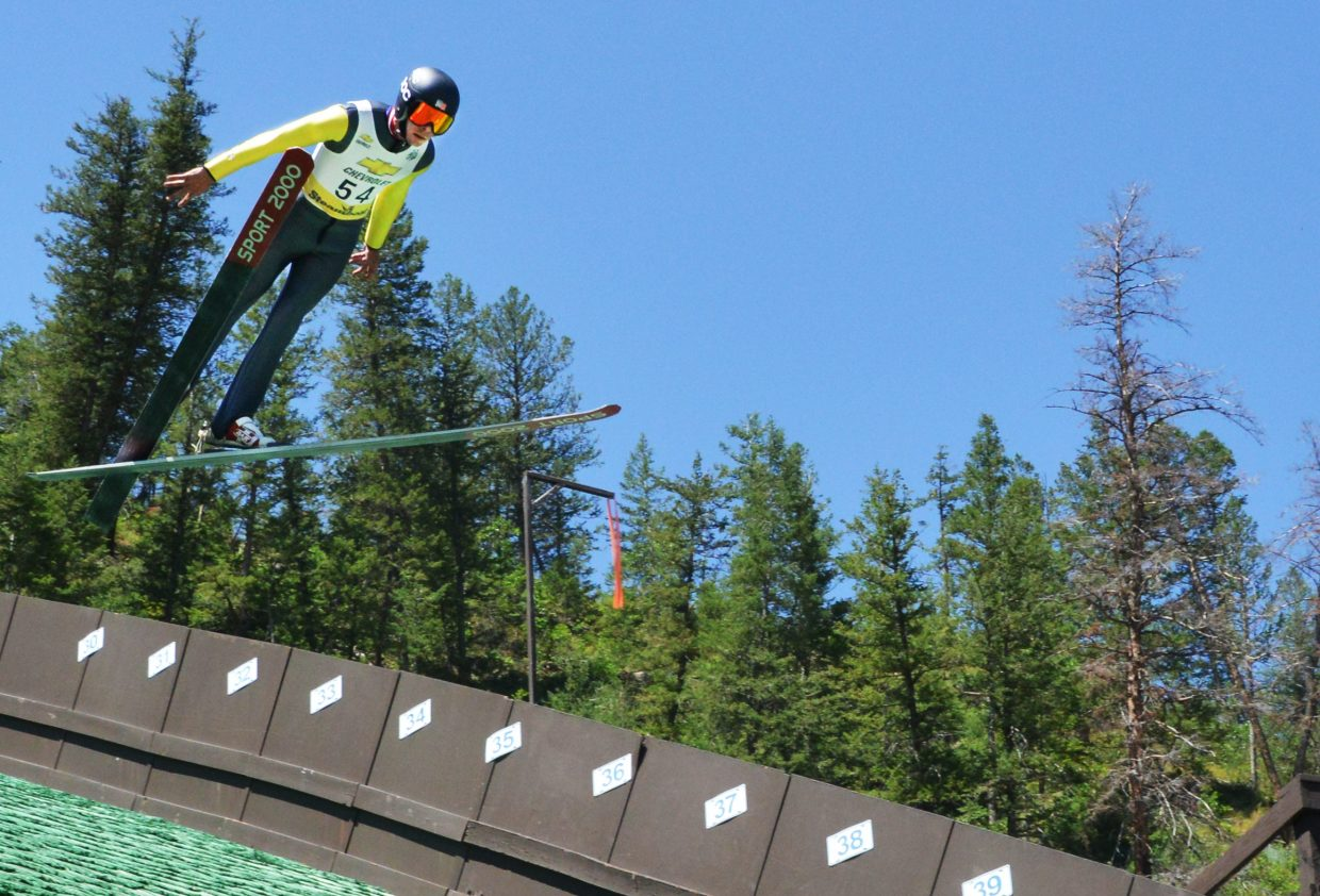 Brett Denney jumps last week in the Ski Jumping Extravaganza event in Steamboat Springs. Denney is among the skiers named to the U.S. Nordic Combined Team.