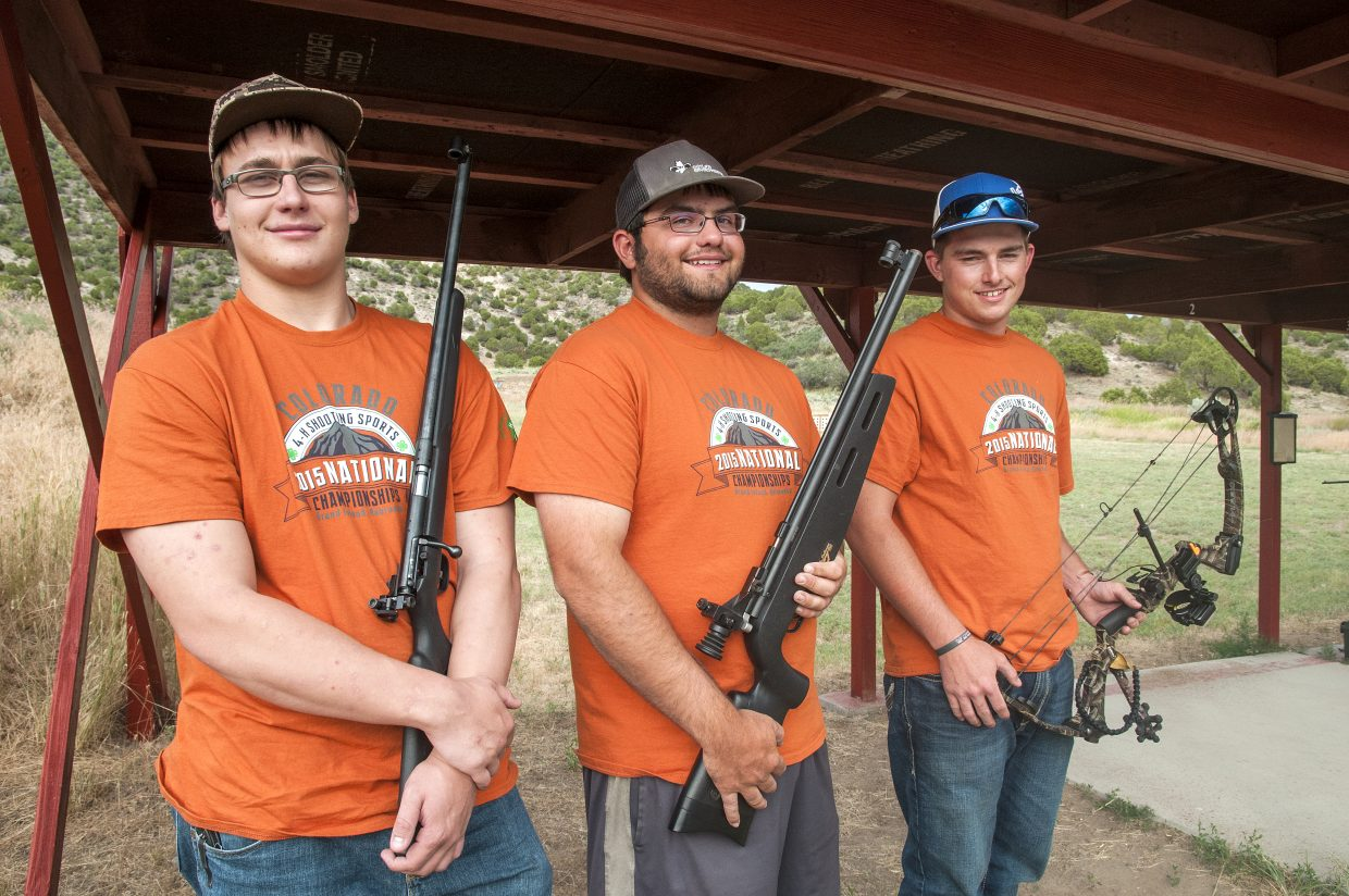 From left, Moffat County 4-H members Hunter Rummel, Dylan Villa and Jordan Kainz hold gear representing each of their events in the national competition which took place June 22 to 26 in Nebraska. Rummel attended in the .22 rifle event in which the Colorado team placed fifth, Villa competed in the air rifle event and Kainz earned a first place finish as part of the compound archery team.