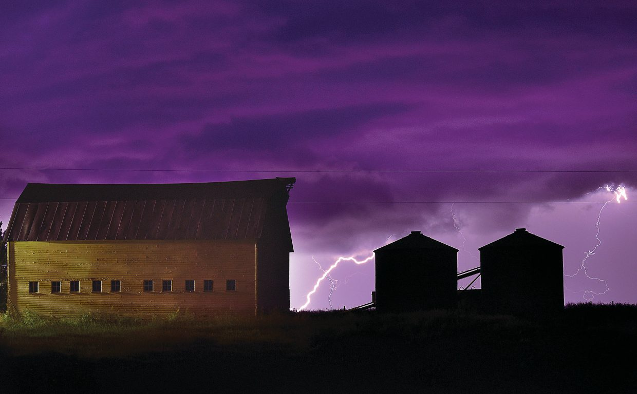 Lightning dances across the night sky about 10 p.m. Monday evening, turning ominous clouds a funky shade of purple as a summer thunder storm passes through the Steamboat II and Silver Spur neighborhoods.