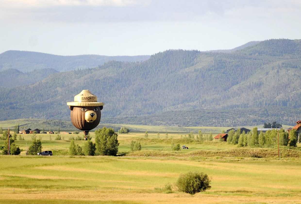 The popular Smokey the Bear hot air balloon flies over the Yampa Valley during the 2015 Hot Air Balloon Rodeo.