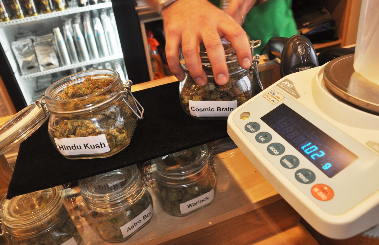 Recreational marijuana is weighed and sold at Rocky Mountain Remedies in Steamboat Springs.