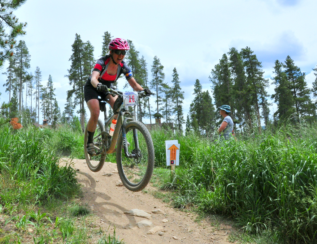 Steamboat Springs mountain biker Becky Edmiston rides over a section of trail in Breckenridge on Saturday during the Firecracker 50 mountain bike race. She went on to place fifth in the women's pro/open division.