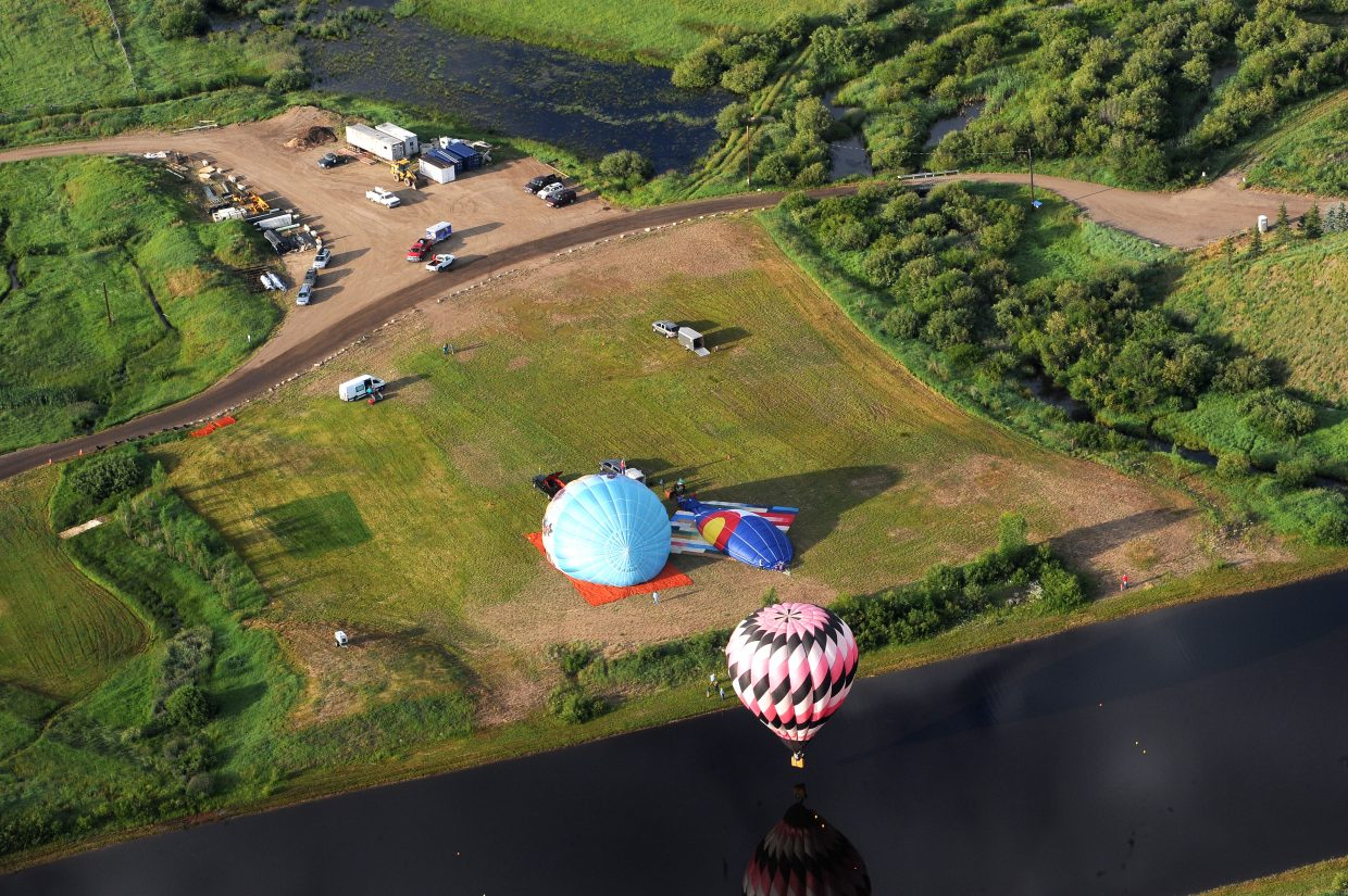 Hot air balloons take off from Bald Eagle Lake on Friday morning.