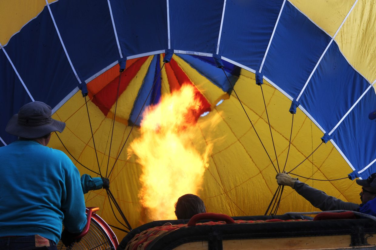 A hot air balloon is inflated at the launch site at Bald Eagle Lake.