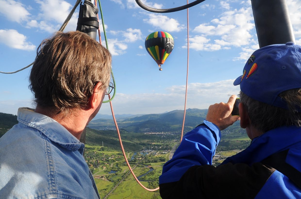 Balloon pilot Gerry Graff, left, and passenger Bill Savage take in the view of the Yampa Valley on Friday morning.
