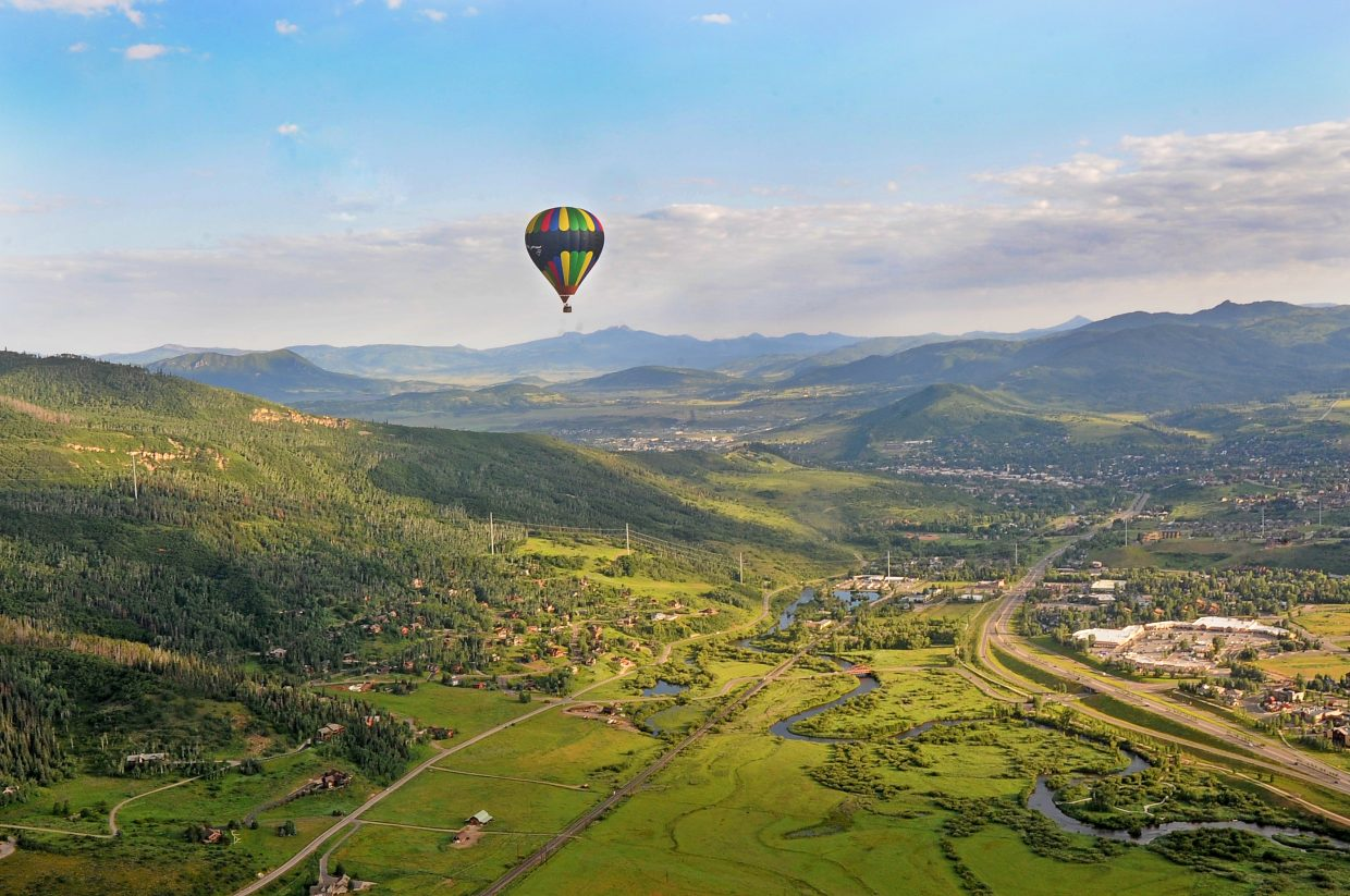 A hot air balloon floats high above Steamboat Springs and the Yampa Valley on Friday as seen from the basket of a balloon piloted by Gerry Graff, of Albuquerque, New Mexico. Several hot air balloons will take off from Bald Eagle Lake and fill the sky on Saturday and Sunday mornings for the Hot Air Balloon Rodeo.