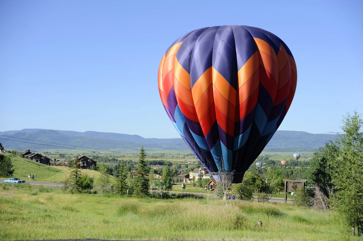 A balloon finds a landing area along Mount Werner Circle during Saturday's Balloon Rodeo.